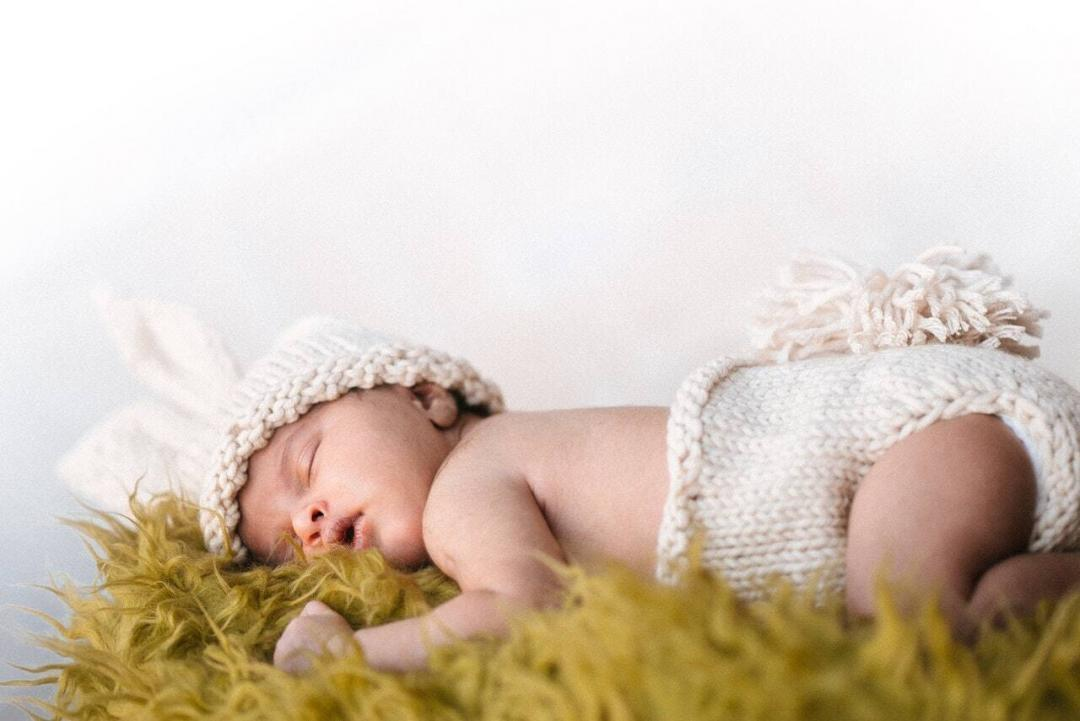 baby asleep on a rug - inositol for fertility post